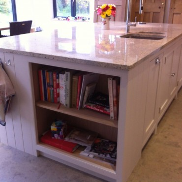 Incorporating open shelving in this island allows the client to keep their cookery books to hand