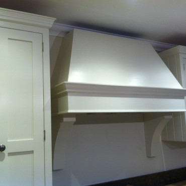 This elegant canopy over the range retains the country look the customer was after