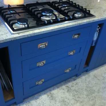 The client wanted a 'wow factor' for her island and chose 'Blue Blood' in the Paint & Paper Library range.  The chrome cabinet furniture worked beautifully with this colour