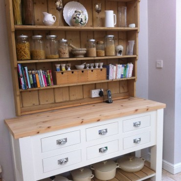 The client used her original shelving to go on top of this new unit to great effect