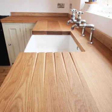 After Nathan installed these beautiful oak worktops he routered in these drainage grooves