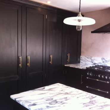 The stunning black and white marble with the matt black cabinets and brass handles made for a dramatic look, guaranteed to be a real talking point